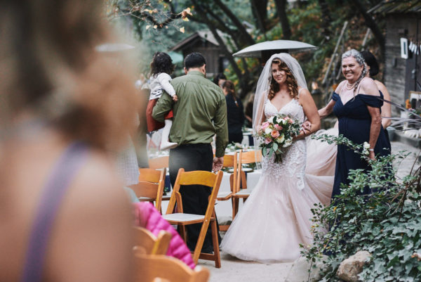 Bride walking down the aisle with mom Cold Spring Tavern Santa Barbara