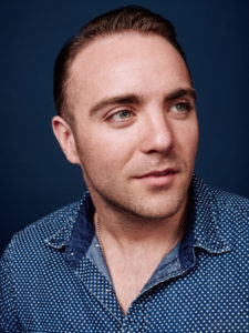 Male studio portrait on blue