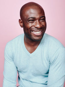 Male studio portrait on pink