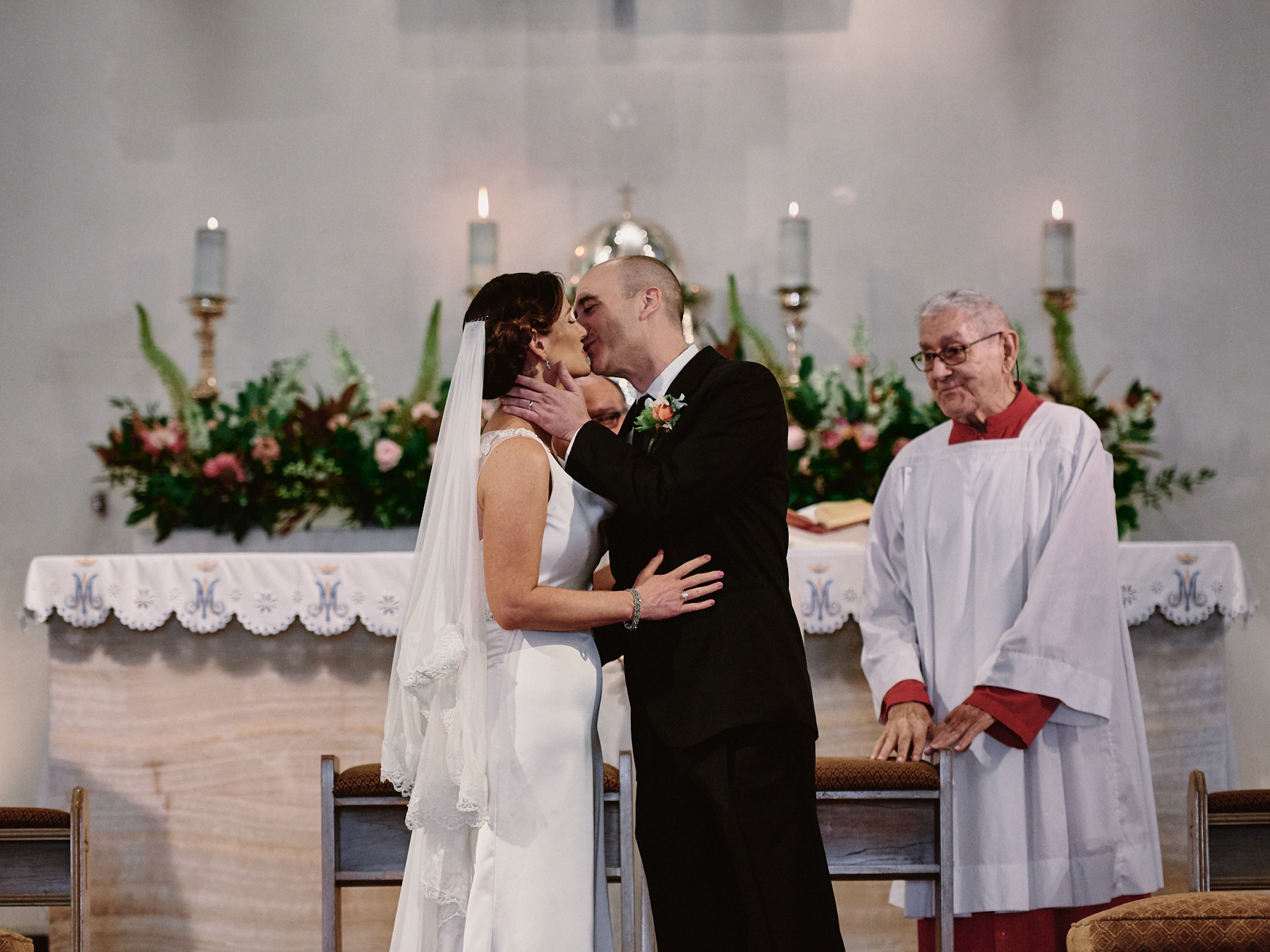 Saint Victor Catholic Church wedding first kiss