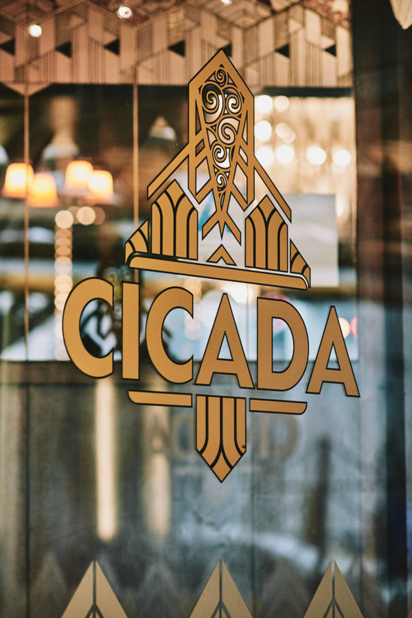 Cicada Club window sign