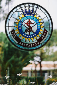 Salvation Army Crestmont College stained glass logo